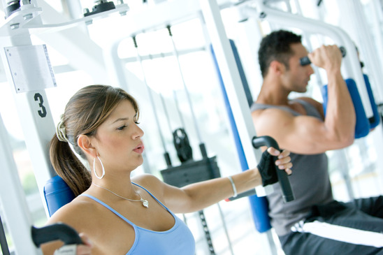 man and woman doing exercises in the gym